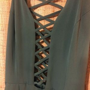 Green plunge-neck jumpsuit with cross-cross detail